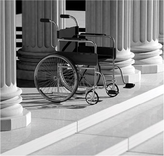 Photo of a empty wheelchair at the steps of the capitol building.