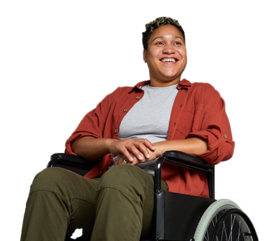A black woman with a disability smiling in a wheel chair.