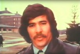 Closeup of Geraldo Rivera in front of Willowbrook Institution talking to television viewers.