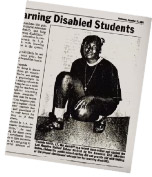 Image of a Newspaper article about Chanda Smith showing a photo of her in scholl kneeling with a basketball in her hand