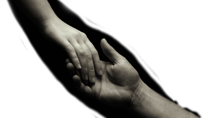 Giving Tuesday - A closeup photo of of a hand reaching out and holding anothers persons hand.
