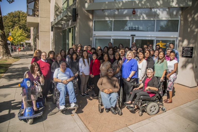 Photo of a large crowd of DRC staff members posing in front of the Sacramento office.