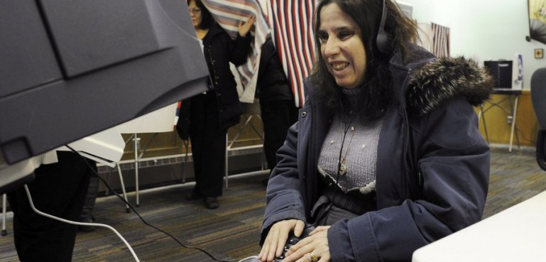 Woman enjoying accessible voting in Alaska.