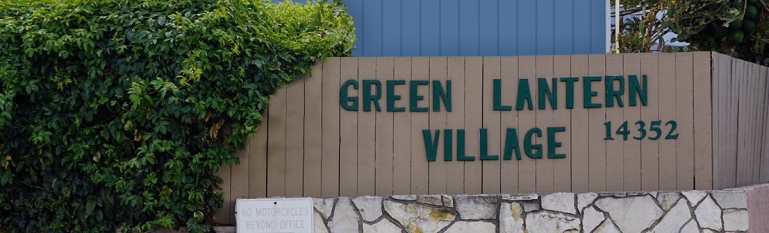 Photo of the front of the mobile home park showing a sign that says Green Lantern Village