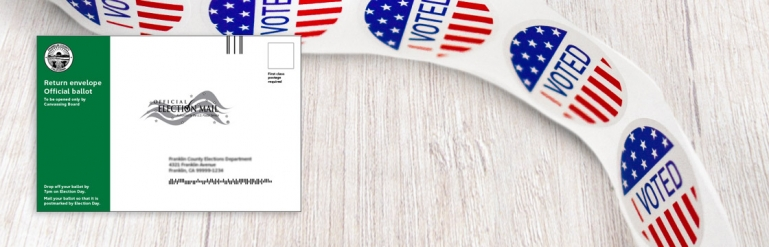 A collage showing the envelope used to mail in a ballot and a small sticker roll. The stickers have a little I Voted symbol.