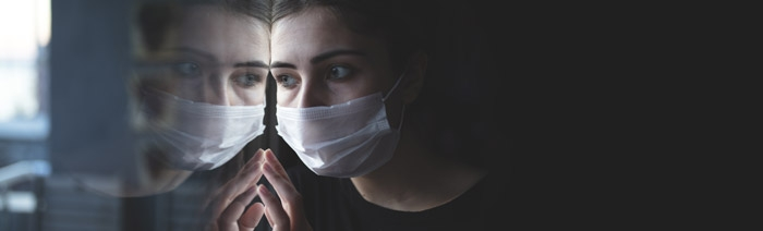 A woman with a medical mask in a Psychiatric Hospital