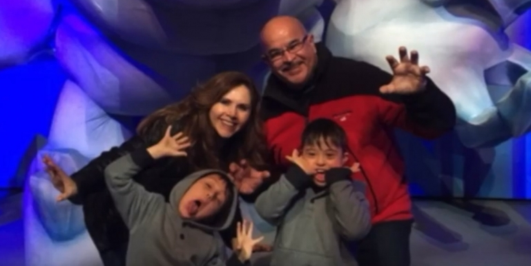 Photo from 40th story showing a family with a mentally disabled child
